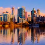 Vancouver skyscrapers along the water with a golden light reflection