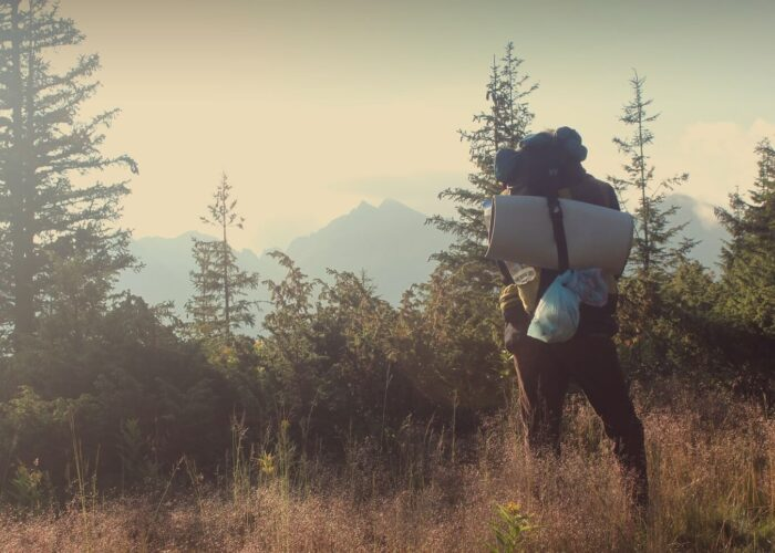 11A hiker with a backpack and gear admires the landscape